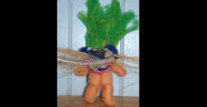 vintage-style troll felted armature with reused toysBack