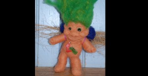 vintage-style troll felted armature with reused toysFront